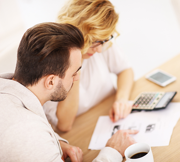 Adult couple working to consolidate their debt